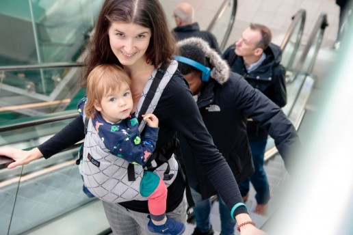 Benefits of babywearing positive effects of carrying for baby isara grey carrier escalator