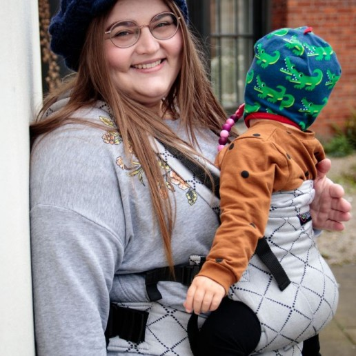 Smiling Carrying Woman carrying baby - credit Steph Oliver-Beech benefits of babywearing